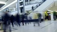 Stock Video Footage of Shoppers moving through busy shopping mall