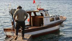 Old fisherman and fisherboat Stock Footage