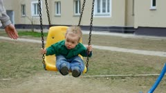 Child with her mother on the playground. Stock Footage