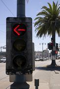 Left turn street signal traffic controller device downtown city corner Stock Photos