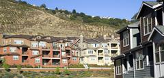 urban sprawl dwellings spring up for domestic living on hillside - stock photo