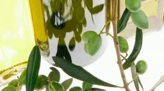 Green olives with gold oil Stock Footage