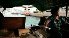 Local female steering boat, HK Stock Footage
