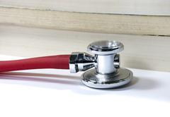 stethoscope and book - stock photo