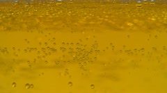 Close up of Bubbles of a Glass of Cold, Fresh Beer, Macro - stock footage