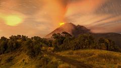 Stock Photo of Tungurahua Volcano Erupting Ecuador South America Very Long Exposure With Star