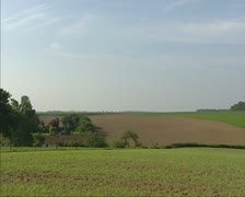 Pan rural landscape of Waterloo Battlefield to monument at horizon Stock Footage