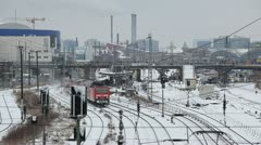 Train passing in industrial aeria in winter snowy Berlin Stock Footage