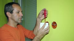Electrician Installing Switch on the Wall - stock footage