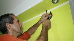Man Working on Electrical Installations - stock footage