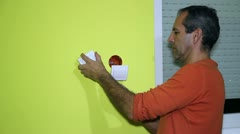 Man Installing an Electrical Switch Stock Footage