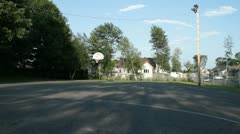 Scenes from the Suburbs - an empty basketball court in the suburbs Stock Footage