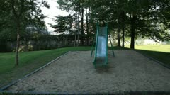 Scenes from the Suburbs - a slide in an empty playground Stock Footage
