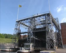 Boat lift in operation with vessel in container descending Stock Footage