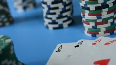 Rolling red dice on background of chips and cards. Stock Footage