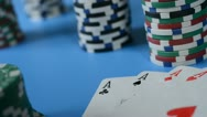 Stock Video Footage of Rolling red dice on background of chips and cards.