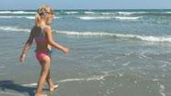 Child Playing, Splashing in Sea Water on Beach, Girl on Coastline, Children Stock Footage