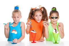 Children with icecream sundae treats Stock Photos