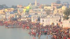 Pilgrims bathing in the Holy Lake at Puskar, India Stock Footage