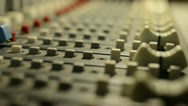 Stock Video Footage of Hand on professional audio mixer. Sharp near of hand, a little DOF.