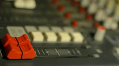 Hand on professional audio mixer. Sharp near of hand, a little DOF. Stock Footage