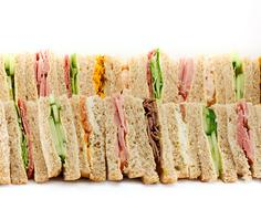 a platter of triangular sandwiches - stock photo