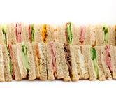 A platter of triangular sandwiches Stock Photos