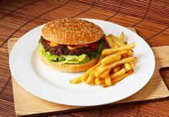 handmade gourmet cheeseburger - stock photo