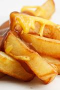 Chips, cheese and gravy Stock Photos