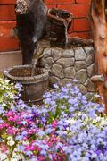 ornamental garden water feature - stock photo