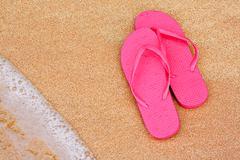 summer vacation background flip flops on beach - stock photo