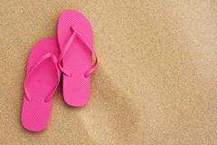 summer vacation background sandals on beach - stock photo
