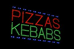 pizzas kebabs light emitting diode sign - stock photo