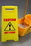 Mopping floor warning sign Stock Photos
