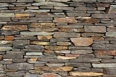 new build flush dry stone wall - stock photo