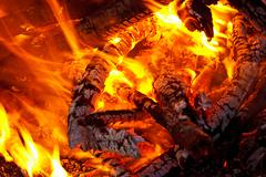 embers glowing in blazing fire - stock photo
