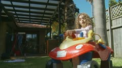 Little girl in toy car - model release Stock Footage