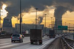 City ringway with vehicles and air pollution Stock Photos