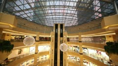 Skyscrapers visible through the glass roof AFIMALL CITY Stock Footage