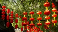 Red lanterns & willow swaying in wind,elements of East,beijing nanluo alley. Stock Footage