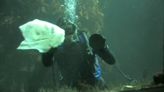Scuba diver cleaning aquarium Stock Footage