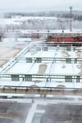 industrial sewage treatment plant with evaporation in winter season - stock photo