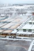 View of industrial sewage treatment plant with evaporation in winter Stock Photos