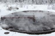 Evaporation in sewage settlers in winter season Stock Photos
