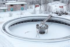covered with snow empty big settlers in sewerage treatment plant - stock photo