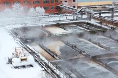 Evaporation on sewage treatment plant in winter season Stock Photos