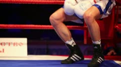 Boxer returns to ring after a break between rounds in WSB match Stock Footage
