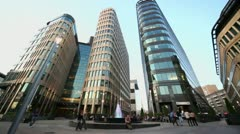 People walk near office buildings of business center Stock Footage