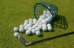 Stock Photo of basket of driving range golf balls