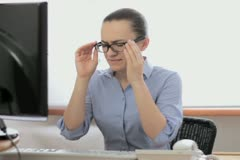 Young businesswoman with tired eyes and headache NTSC Stock Footage